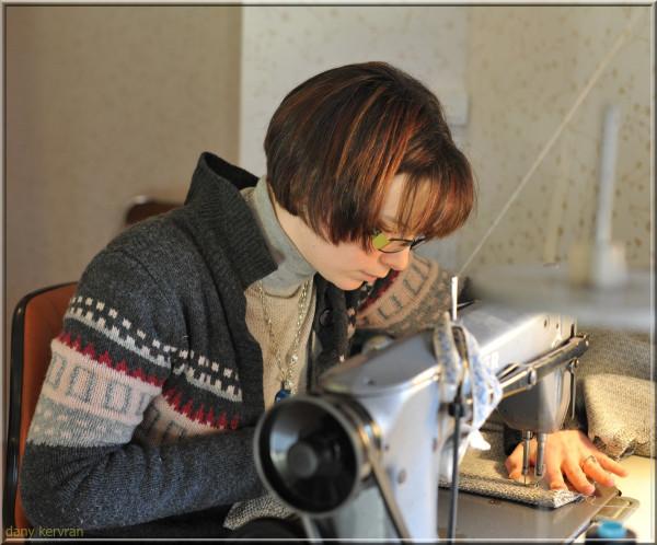 a dressmaker in her workshop