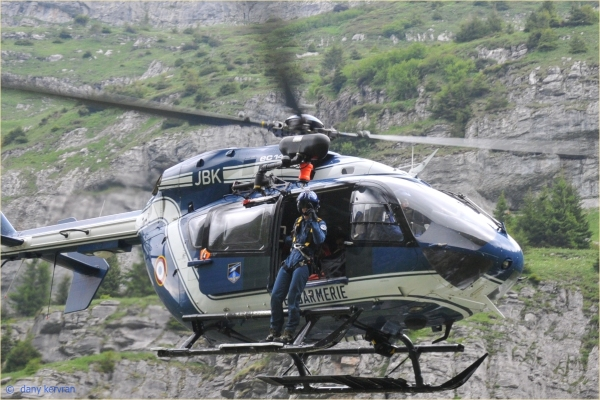 a first-aid policeman outside of an helicopter