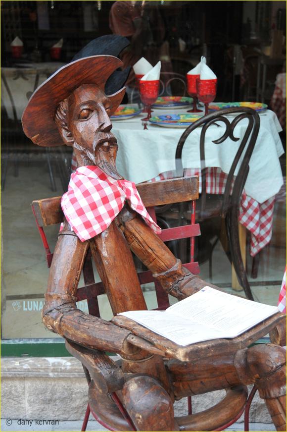 a wooden Don Quixote shows a menu