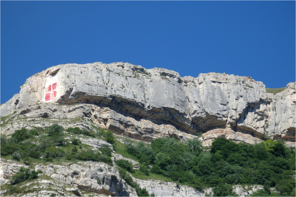 the Cross of Savoy painted on the Salève mountain