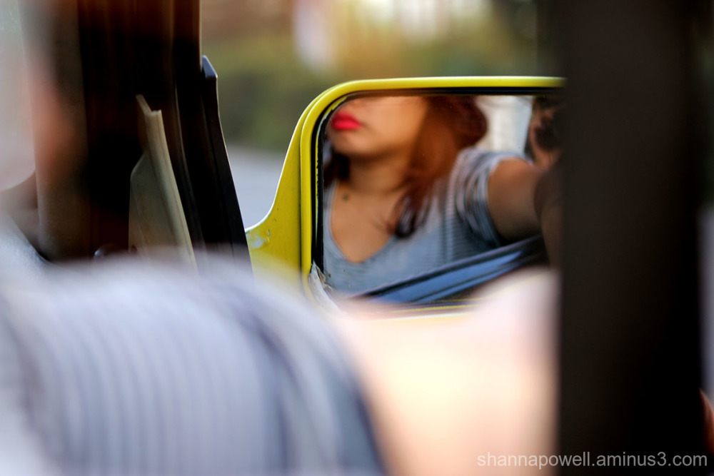Reflection of girl's lips in car mirror