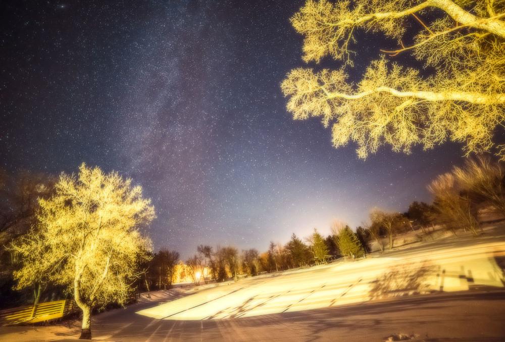 Frozen pond at night