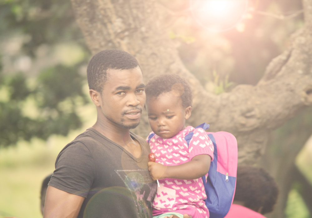 man and child in port st johns