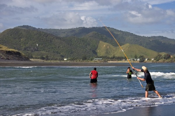 Fishing on the beach of Marokopa