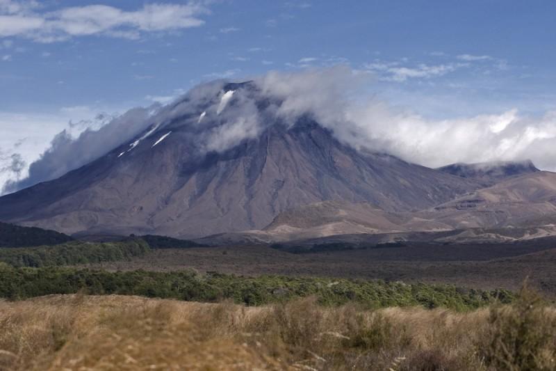 Mount Doom volcano with cloud layer