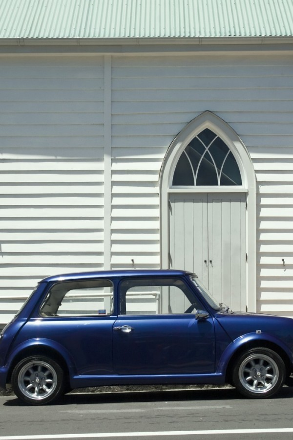 Blue mini by church on white
