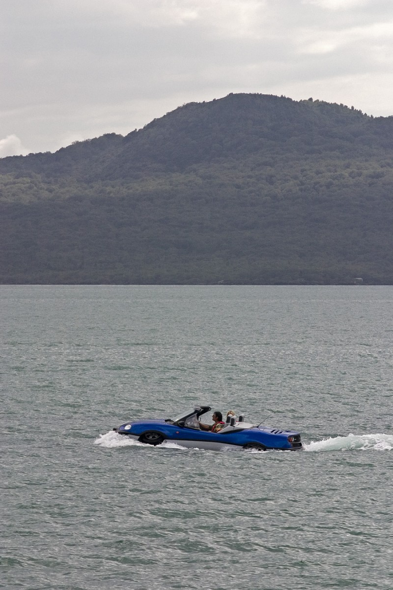 Boat car cruising by Rangitoto