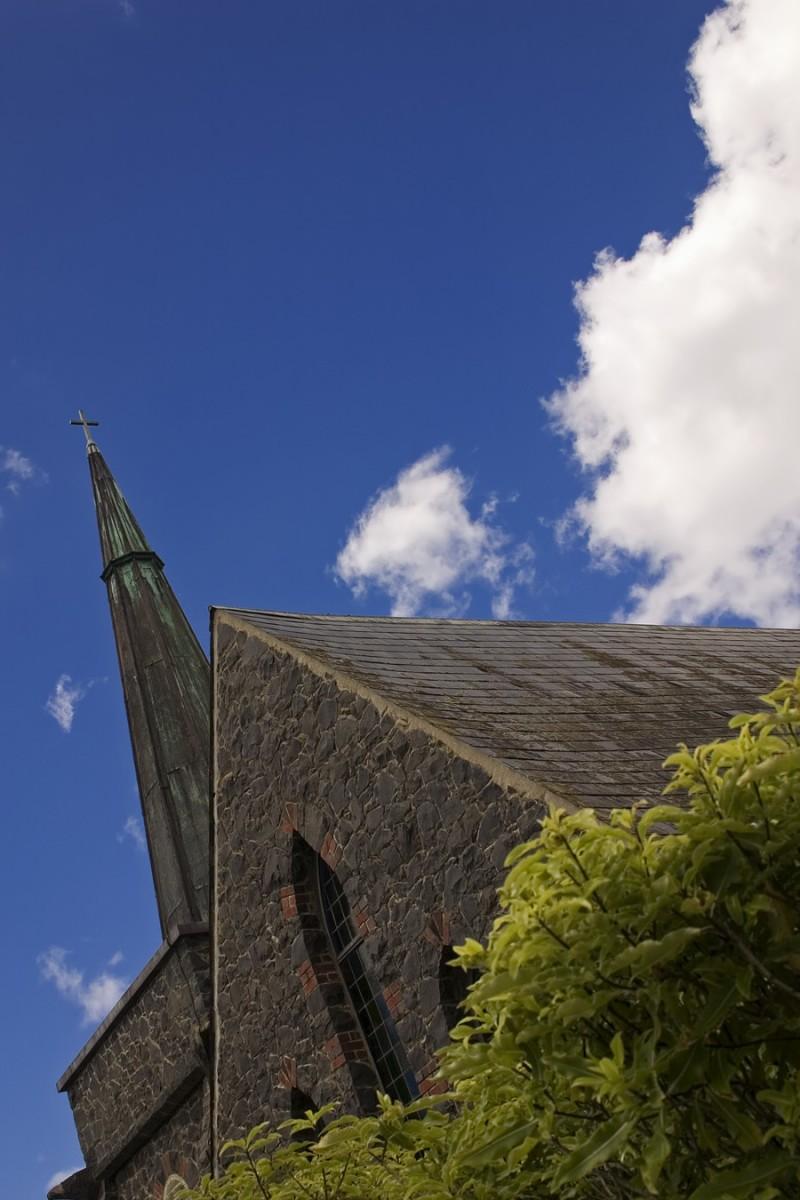 Stone church on blue sky
