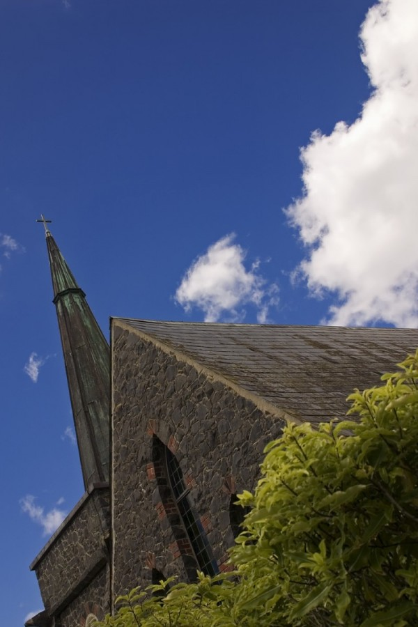 Stone church on blue sky