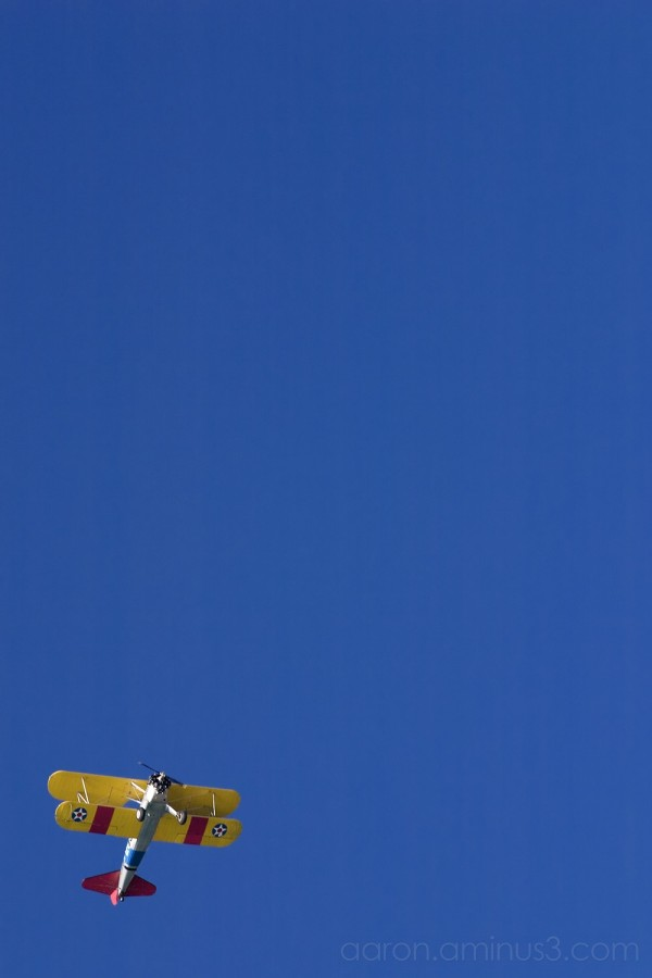 Prop plane on blue sky