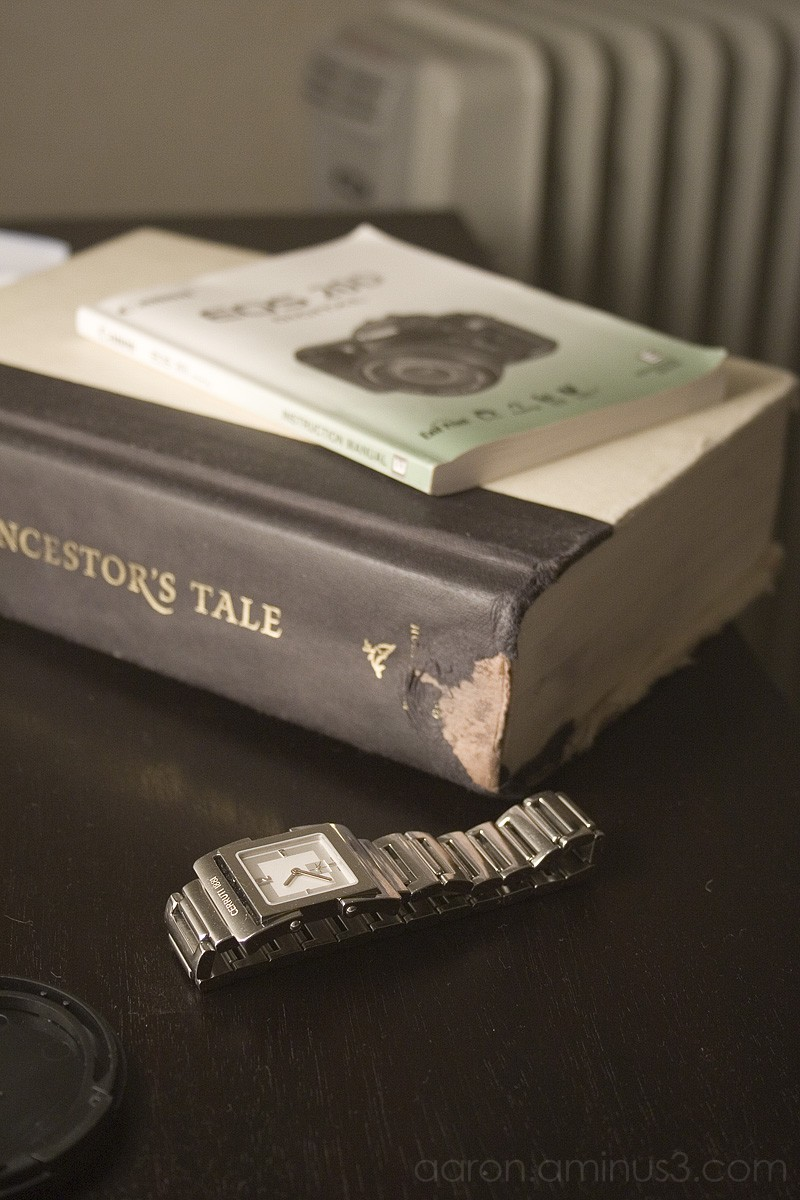 Book and watch on bedside table