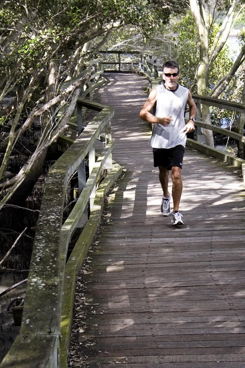 Runner on the wooden bridge