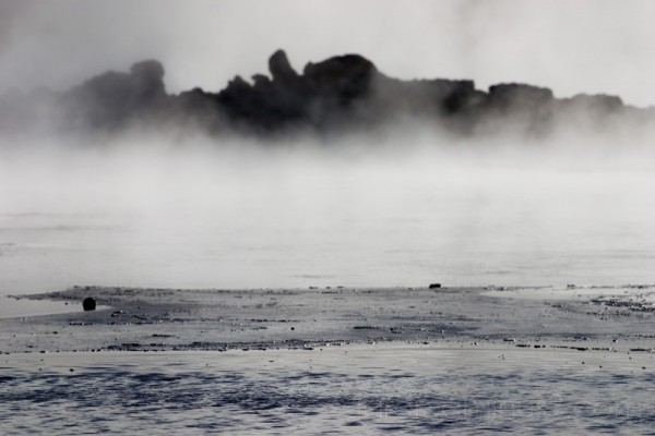 Steam rising over the mud