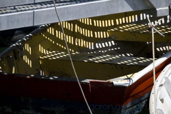 Boat under the metal dock