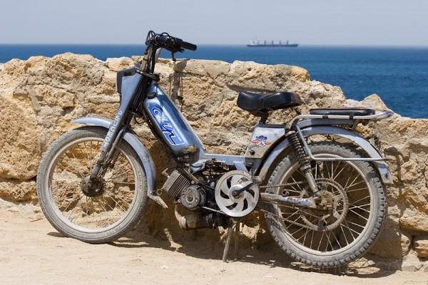 Motorbike by stone wall