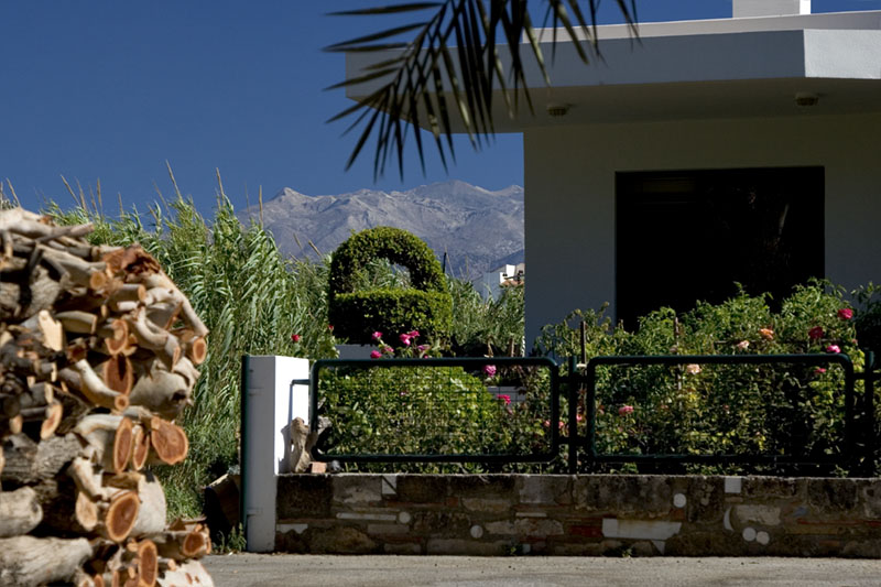 Crete beach house mountains wood pile