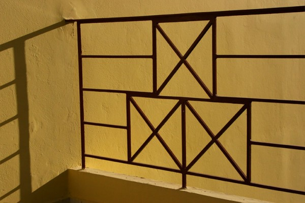 abstract yellow railing shadow