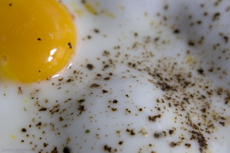 fried egg yolk pepper macro