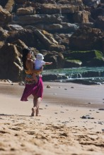 woman and baby on beach