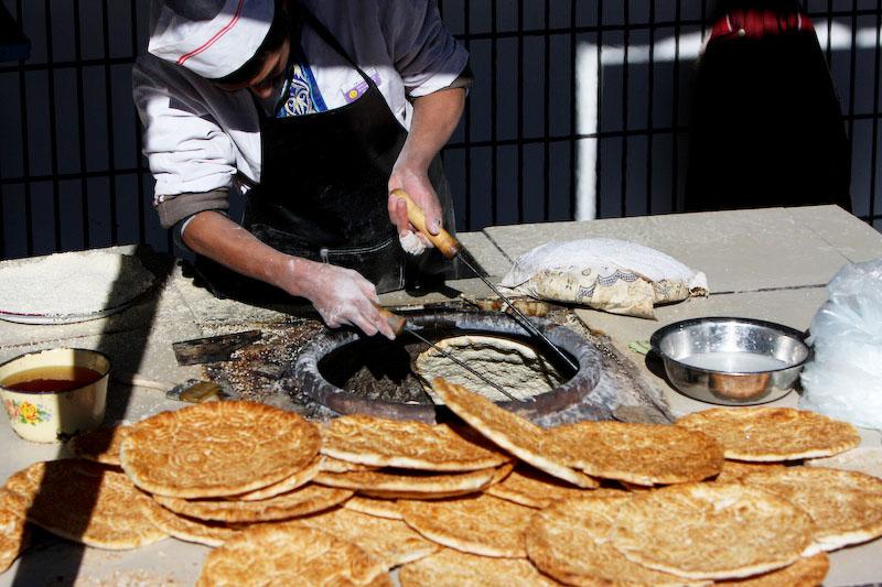 man making naan China