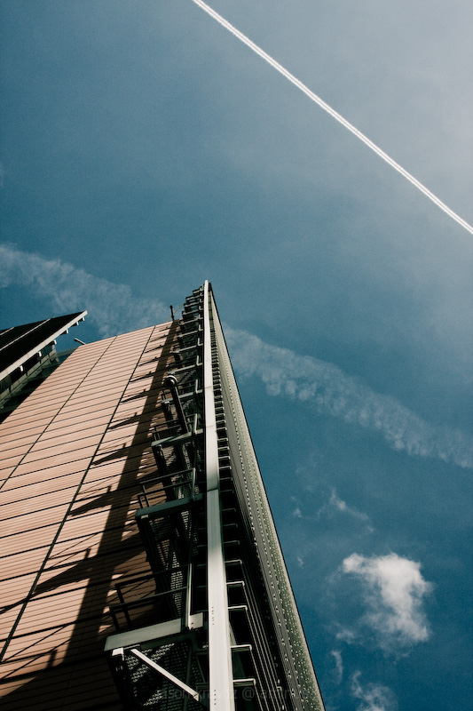 contrail sky and building