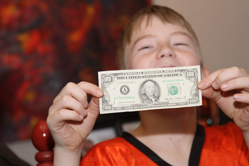 kid with $100 bill
