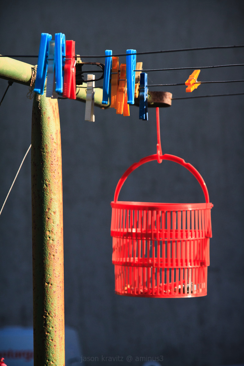 red bucket clothespins