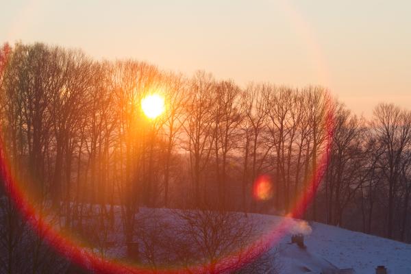 sun flares over chimney's yonder