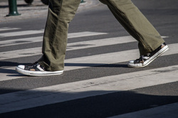 converse in a crosswalk