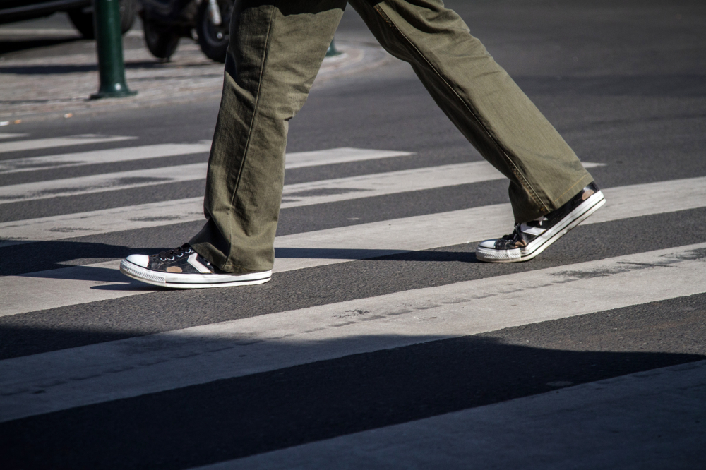 converse in a crosswalk