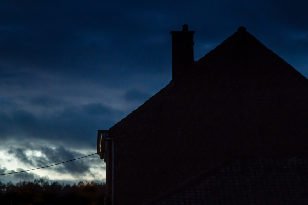 house silhouette at dusk