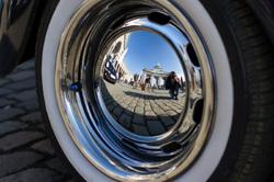 Cinquantenaire in a Volswagen Beetle hubcap