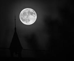 amazing full moon over a Belgian chapel