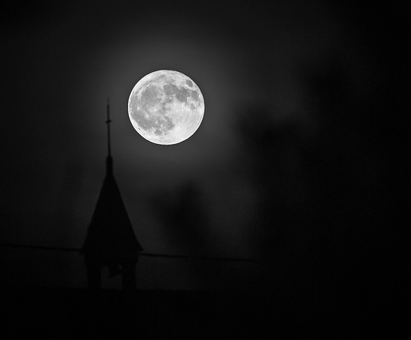 amazing full moon over a Belgian chapel