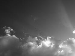 sun bursting through clouds