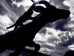 tom frantzen sculpture with dramatic clouds