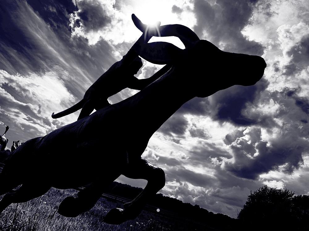 tom frantzen sculpture with dramatic clouds