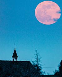 full moon over belgium chapel