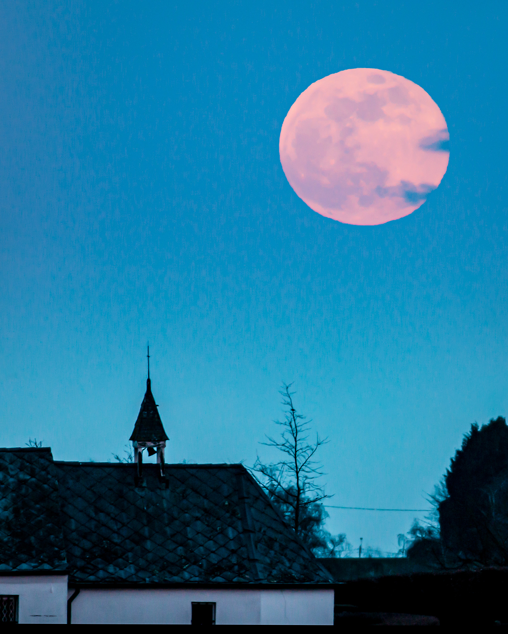 full moon over belgium chapel