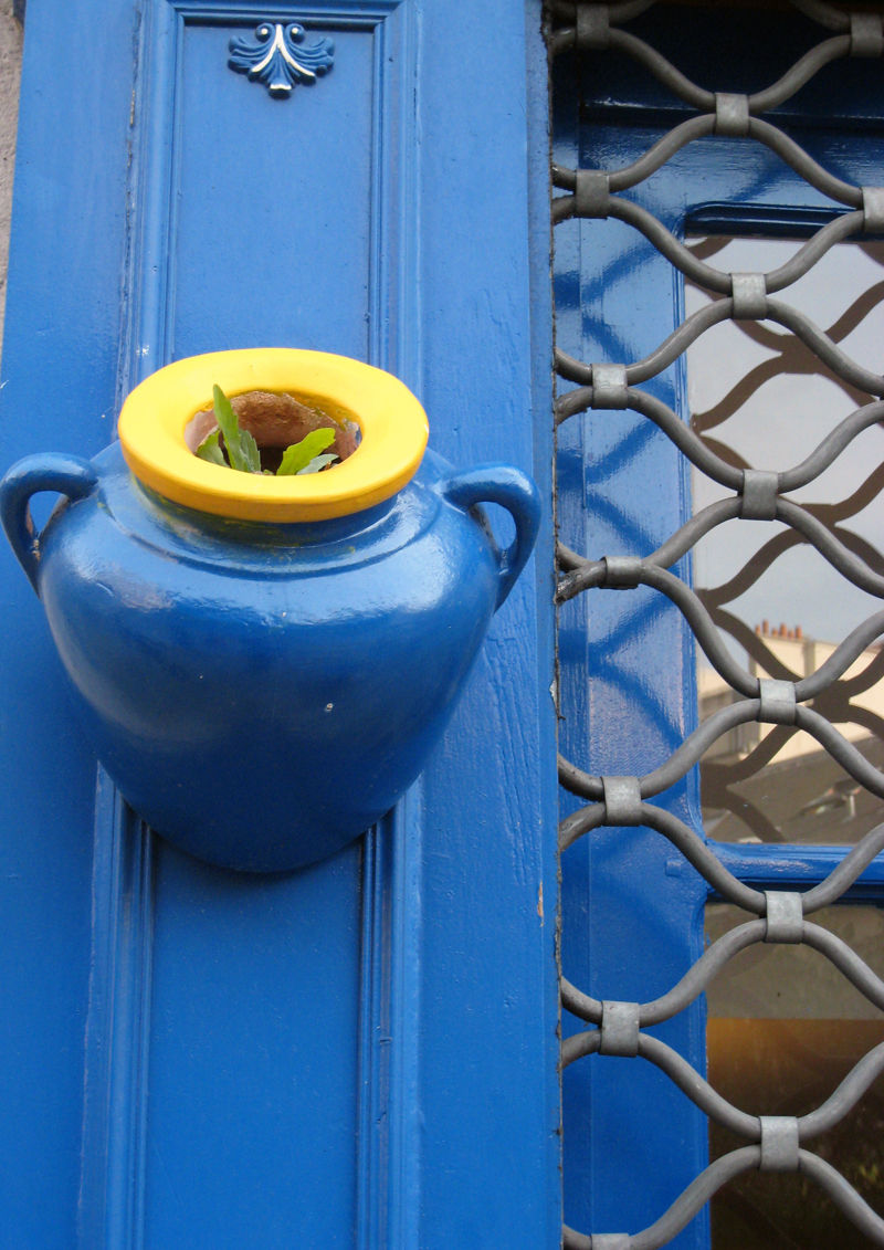 blue pot on blue wall in paris