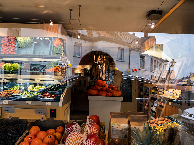 A store front facade or a shadowy illumination?