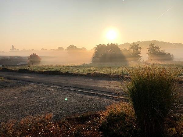 A foggy morning begins