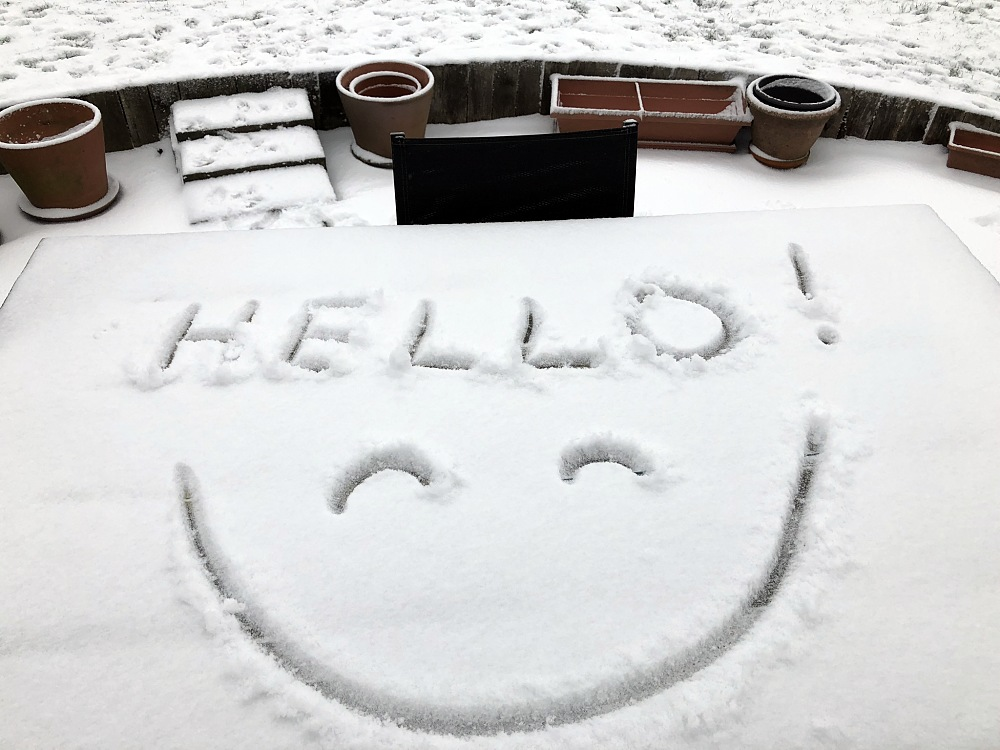 snow on table with smiley face