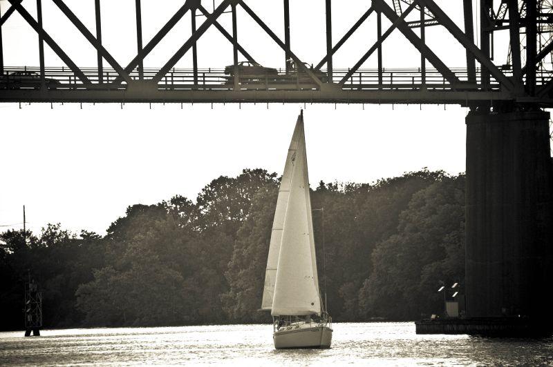 sailboat under Burlington Bristol bridge