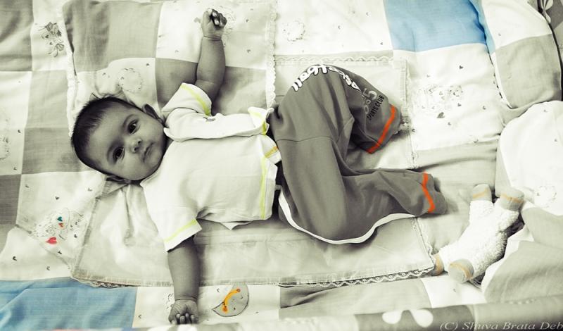 Tisha in her crib