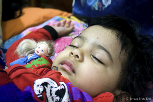 Tisha with her doll