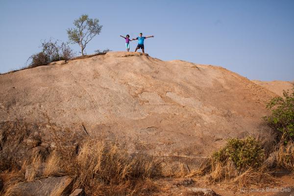 Father and daughter enjoying micro rock climbing