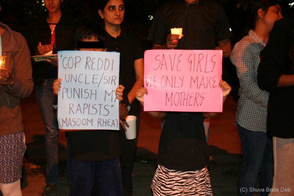 Candle light protest against child abuse 7/10