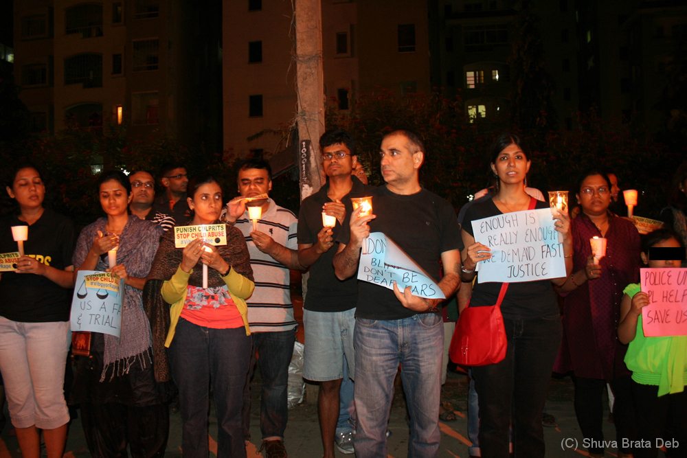 Candle light protest against child abuse 8/10