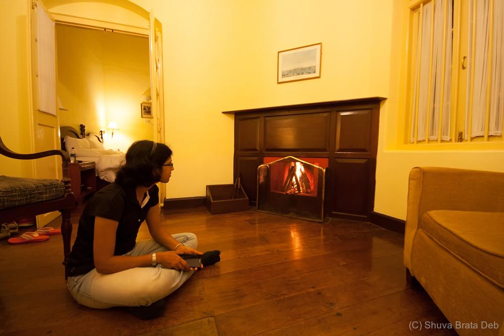 Sitting near an English fireplace